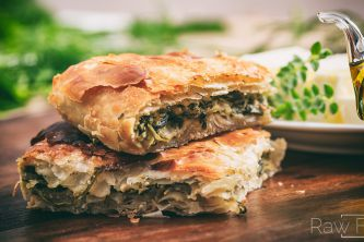 Greek savory pastry. It is filled with spinach, feta cheese, eggs, onions, and seasoning
